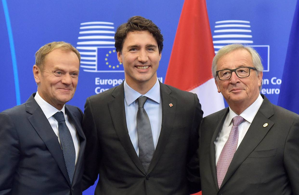 eu and canada Canadian prime minister justin trudeau has joined eu officials to sign a landmark trade deal in brussels the deal, seven years in the making, was held up last week amid opposition from a belgian region.