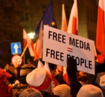 Thousands protest new media restrictions in Poland