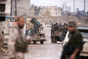 Syrian government soldiers gather in Al-Haidariya neighbourhood after government forces took control of the area in Aleppo
