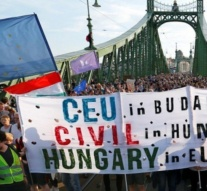 Hungarians march against crackdown on universities, NGOs