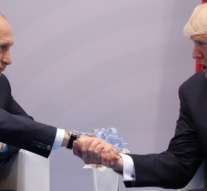 Trump presses Putin at first meeting on interference in U.S. election
