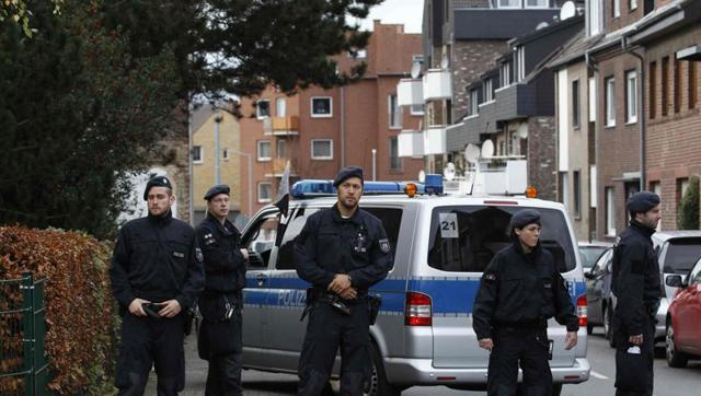 German police raid homes of suspects 'threatening state'