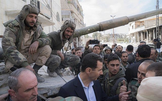 Bashar al-Assad visits army in Eastern Ghouta as attacks continue