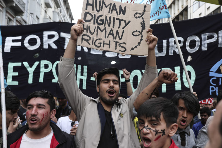 Migrants stranded in Greece march against racism