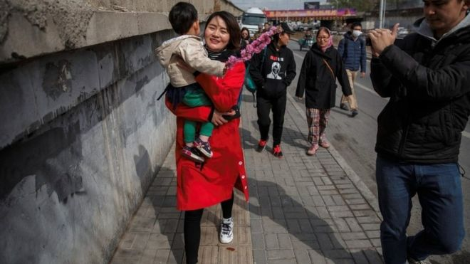 China human rights: Wife marches for 'vanished' husband