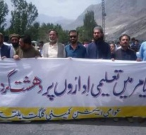 Kashmir: Awami Action Committee protest the torching of 14 schools