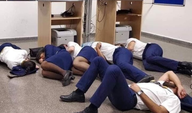 Ryanair sacks cabin crew pictured 'sleeping on airport floor'