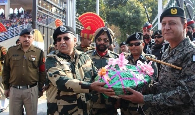 Pakistani, Indian border forces exchange sweets on India's Republic Day