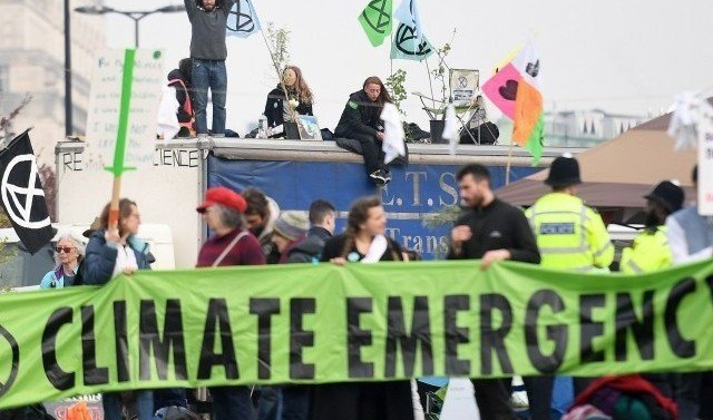 UK police say total of environment activists arrested passes 700