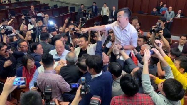 Hong Kong lawmakers fight over extradition law