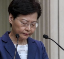 Hong Kong leader warns protesters not to push city into 'abyss'