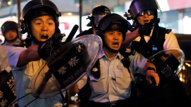 Hong Kong police fire gun and use water cannon on protesters
