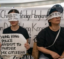 Anti-government protesters face off with Hong Kong riot police