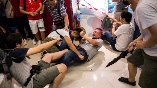 Hong Kong protesters clash with pro-Beijing counterparts