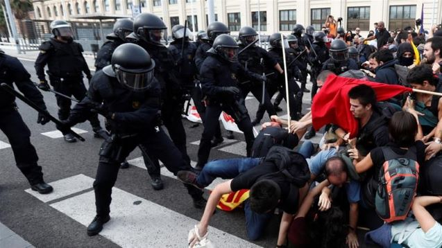 Puigdemont turns himself in; protests paralyse Catalonia
