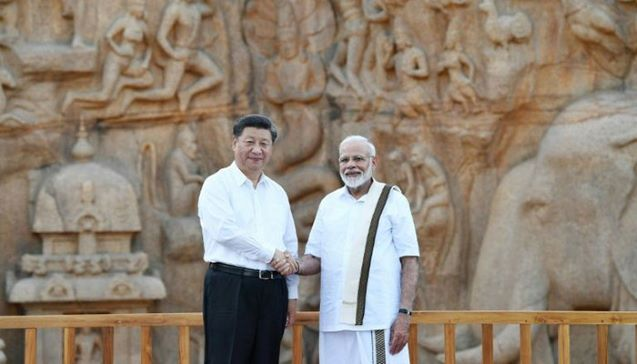 At summit to mend ties, Modi, Xi see common challenge
