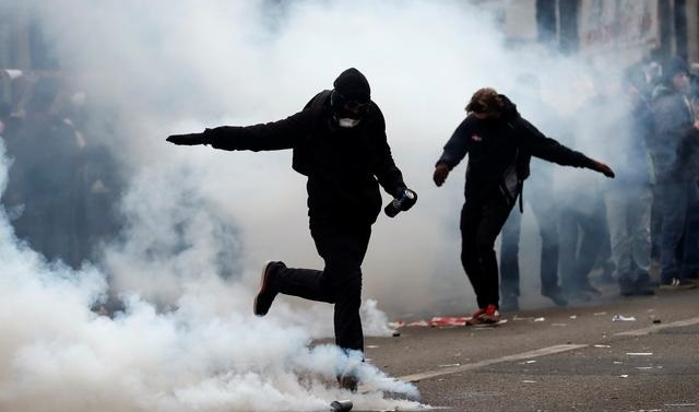 French police fire tear gas at strikers challenging Macron reform