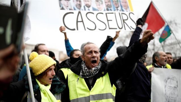 Police use tear gas in new 'yellow vest' protests in Paris