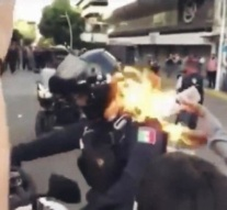 Patrol officer SET ON FIRE during police brutality protests over 'Mexican George Floyd'