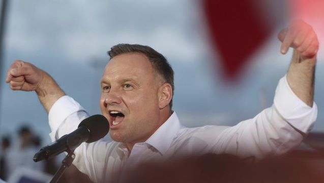 Poland votes: Election exit poll projects narrow victory for incumbent Andrzej Duda