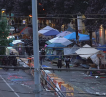 America: Seattle police arrest remaining protesters after mayor orders violence-plagued encampment to shut down
